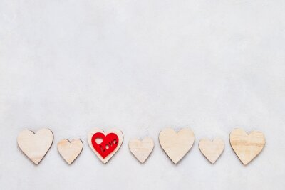 Valentines Day background. Wooden hearts on a concrete background, top view. Valentines Day concept. Copy space