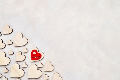 Valentines Day background. Wooden hearts on a concrete background, top view. Valentines Day concept. Copy space, top view