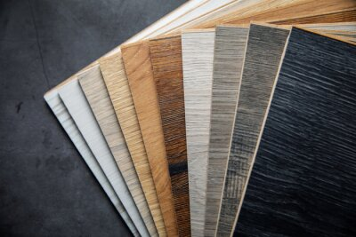 variety of laminate material samples on dark stone background