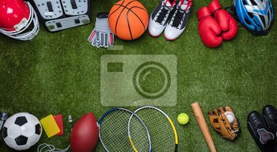 Naklejka Various Sport Equipments On Grass