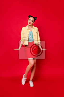 Vertical photo of funny lady casual cool street look isolated red background