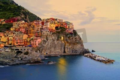 Naklejka Village of Manarola, Italy on the Cinque Terre coast at sunset