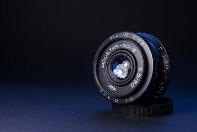 Vintage former Soviet manual Industar 50 2 camera prime lens on black background