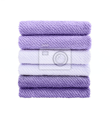Violet bath towels in stack isolated over white.