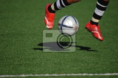 Wizerunek piłkarza dotykania piłki