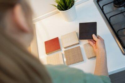 woman choosing kitchen furniture material texture