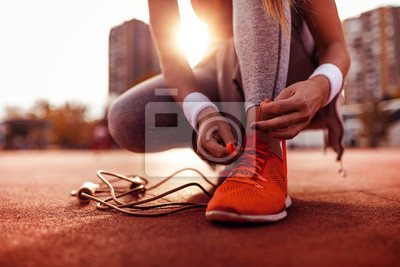 Naklejka Woman preparing for jogging