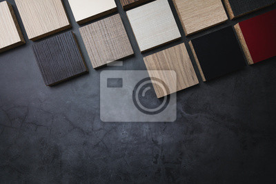 wood texture laminate furniture material samples on dark stone background with copy space