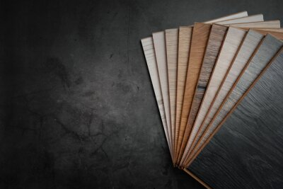 wood texture laminate material samples on black stone background with copy space