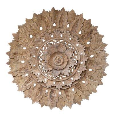 Naklejka Wooden pattern of flower on carve teak wood in circle shape.