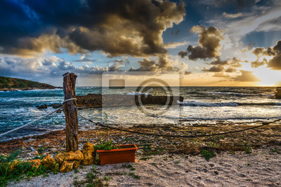 Wooden pole and rope in Alghero shore
