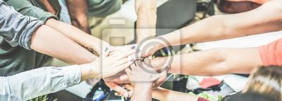 Naklejka Work team stacking hands together for new startup project