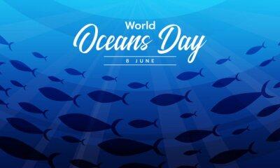 Naklejka world ocean day text on a group of mackerel swimming under the ocean vector design