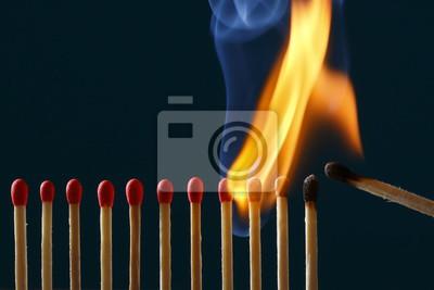 マ ッ チ に 火 を つ け る