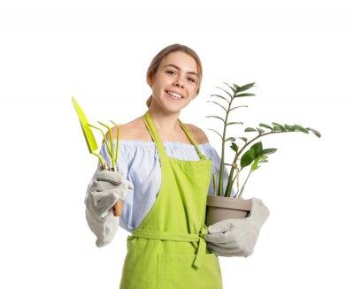 Naklejka Young female gardener on white background