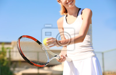 Young woman playing tennis on court