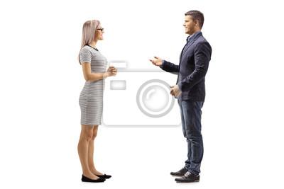Naklejka Yung man and woman standing and talking