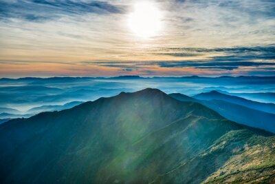 Naklejka Zachód słońca w górach