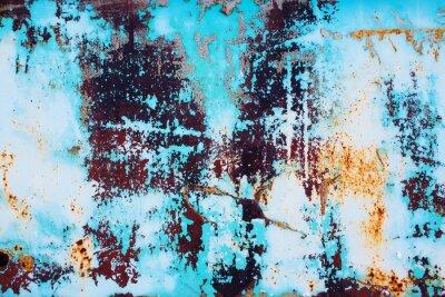 Naklejka zardzewiały metal z krakingu niebieskiej farby. kolorowe tło zardzewiałych powierzchni żelaza z jasnego farby peeling i pękanie tekstury