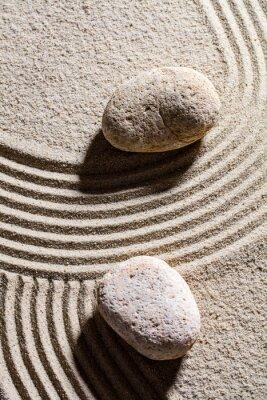 Naklejka zen piasku still-life - dwa kamienie ustawione w poprzek linii Piasek koncepcji duchowości i spokój, widok z góry