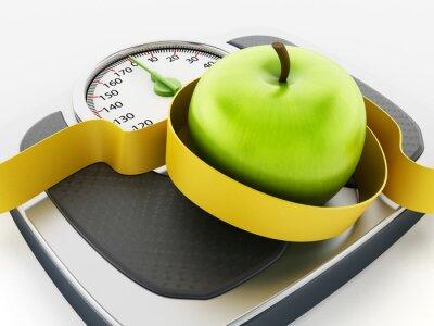 Naklejka Zielone jabłko i taśmy środka na skali wagi