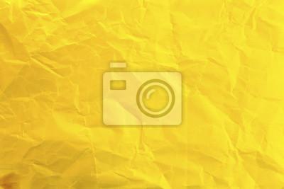 Naklejka Zmięty żółty papier jako tło