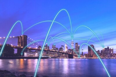 Obraz 5g smart city communication network concept in New York - Downtown Manhattan night view with abstract links connecting buildings, wireless, visualisation of the internet of things