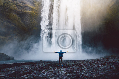 Obraz A person admirnig the beauty of Skogafoss waterfall located in Iceland