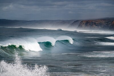A set of waves breaking at the Bordeira Beach (Praia da Bordeira) in Algarve, Portugal