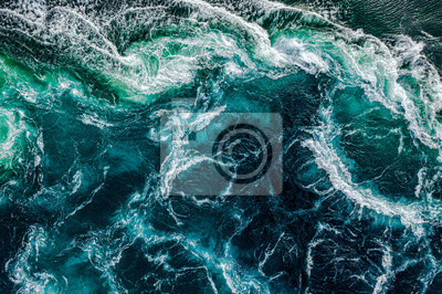 Obraz Abstract background. Waves of water of the river and the sea meet each other during high tide and low tide. Whirlpools of the maelstrom of Saltstraumen, Nordland, Norway