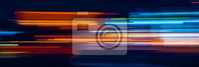 Obraz Abstract Rainbow light trails on the dark background