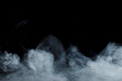 Obraz Abstract white smoke moves on black background. Beautiful swirling gray smoke.