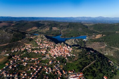 Aerial drone photo of the traditional village of Penha Garcia, with the lake on the background, in Portugal.