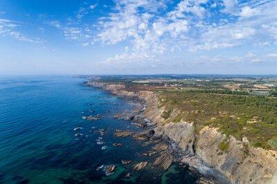 Aerial view of the coastline and cliffs near the Esteveira Beach in Aljezur, Algarve.