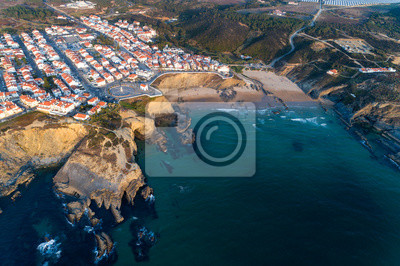 Aerial view of the Zambujeira do Mar village and beach at sunset, in Alentejo, Portugal;
