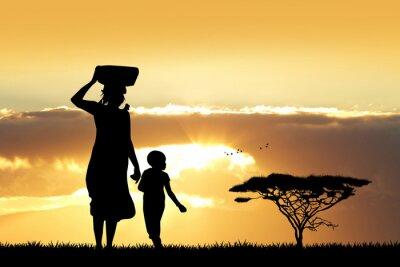 Obraz Afrykańska kobieta i syn o zachodzie słońca