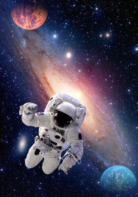 Obraz Astronauta Spaceman zewnętrzna przestrzeń ludzi galaxy planeta układu słonecznego wszechświata. Elementy tego zdjęcia dostarczone przez NASA.