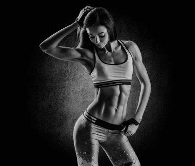 Obraz attractive fitness woman, trained female body, lifestyle portrai