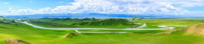 Obraz Bayinbuluke grassland natural scenery in Xinjiang,China.The winding river is on the green grassland.Panoramic view.