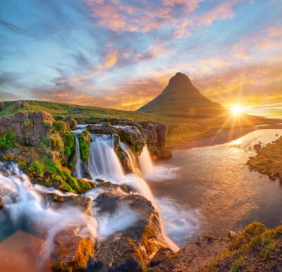 Obraz Beautiful landscape with sunrise on Kirkjufellsfoss waterfall and Kirkjufell mountain, Iceland, Europe.