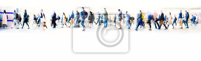 Obraz Beautiful motion blur of walking people in train station. Early morning rush hours, busy modern life concept. Ideal for websites and magazines layouts