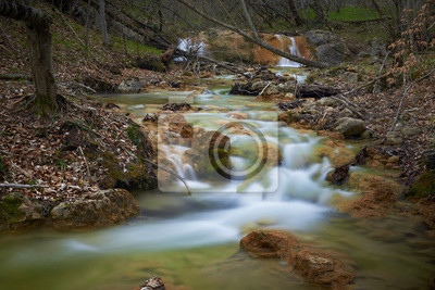 Beautiful river with waterfall in national park forest