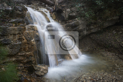 Beautiful waterfall with fallen water in forest