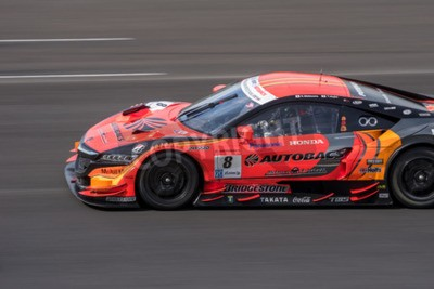 Obraz BURIRUM, THAILAND - JUNE 21 : Kosuke Matsuura of AUTOBACS RACING TEAM AGURI in Super GT Final Race 66 Laps at 2015 AUTOBACS SUPER GT Round 3 BURIRAM SUPER GT RACE on June 21, 2015 in Burirum, Thailand
