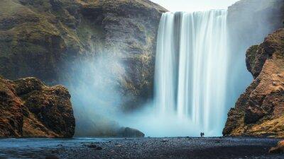 Obraz Couple of tourist near famous Skogafoss waterfall, Iceland