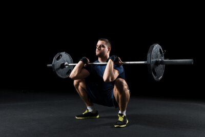 Obraz Crossfit athlete performs  weight lift