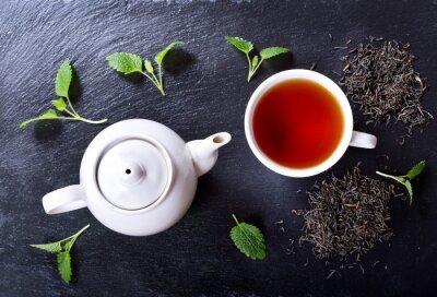 Obraz Czajnik i filiżanka herbaty z mięty