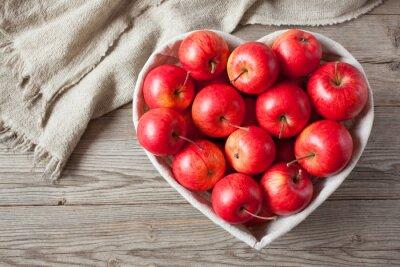 Obraz Czerwone jabłka na stole