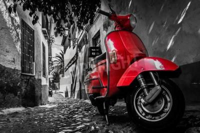 Obraz Czerwony skuter vespa zaparkowany na utwardzonej ulicy