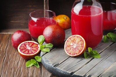 Obraz Delicious soku z czerwonych pomarańczy i mięty